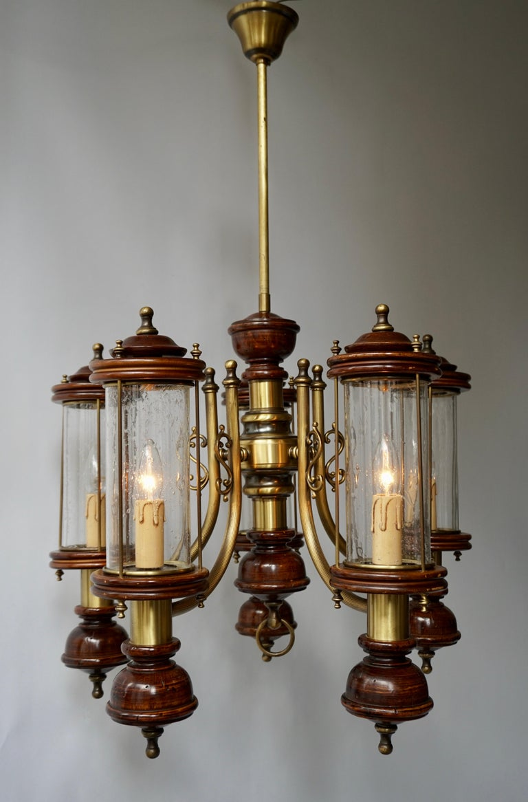Beautiful five-light chandelier in glass brass and wood.