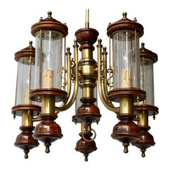 Chandelier is Glass, Brass and Wood
