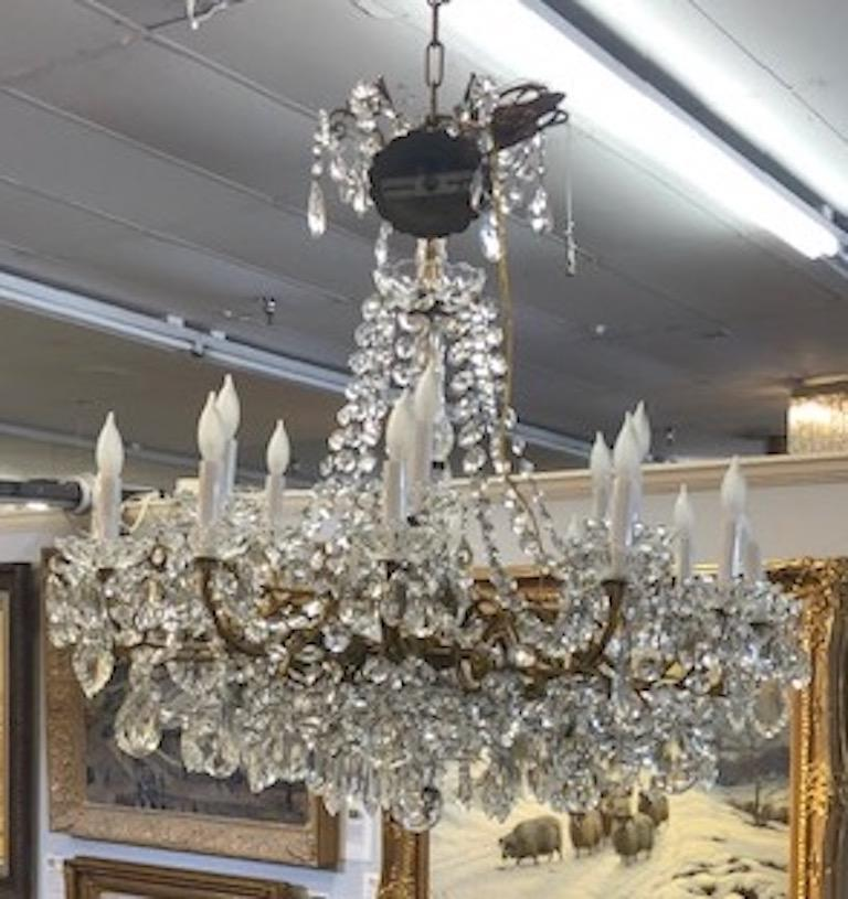 """Chandelier Maria Teresa style with   crystal ornaments. Beautiful chandelier illuminated by the 18 light candles, circa 1910s.   Condition is very good. Rewired.  Measures: 37"""" H x 31"""" W."""