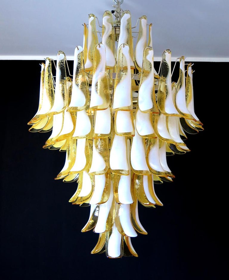 Handblown glass chandelier, composed of 85 curved,  caramel lattimo glass pieces, which are arranged on 7 tiers, suspended from a nickel metal structure. Period:late xx century Dimensions:  47,25 inches (120 cm) height without chain; 31,50 inches