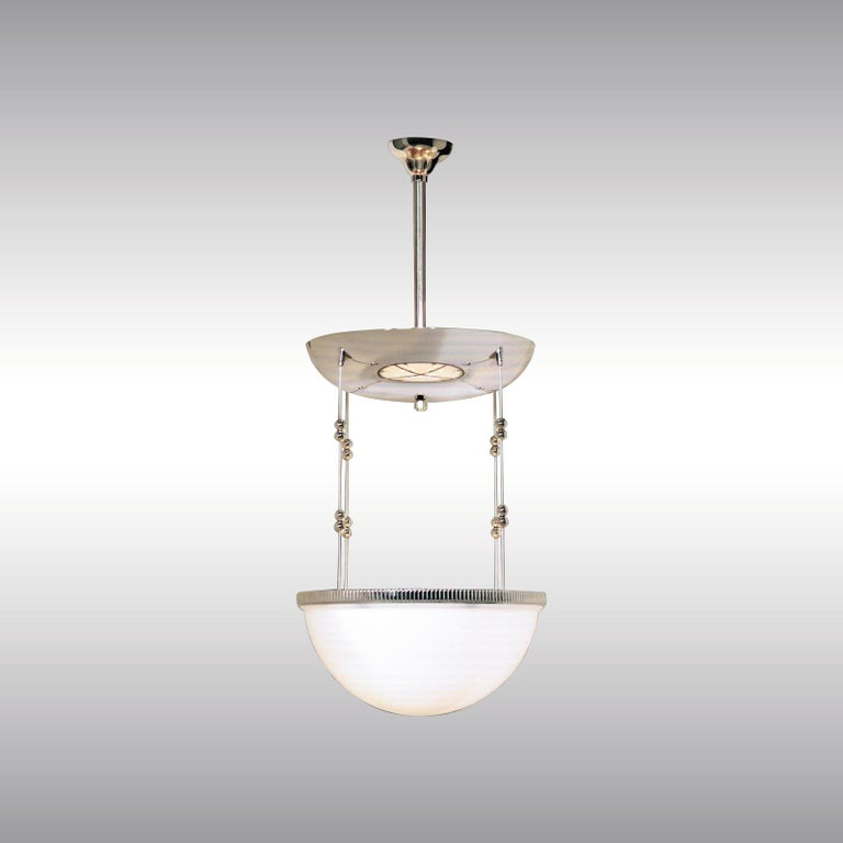 A chandelier which can illluminate a ceiling rosette from the bulbs inside the metal-part which is a mirror and reflect the light from the bulbs inside the glass-bowl. A smaller version with 35cm diameter (13.8