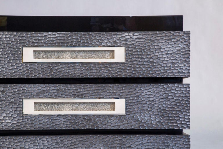 """Black piano lacquered main body, with three """"bands"""" of carved silver oak drawers featuring  silvered bronze handles. The insides of the drawers are lined with felt.  Custom sizes, finishes, materials available."""