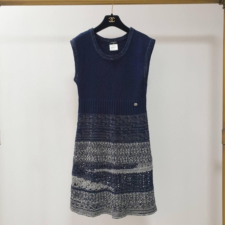 Chanel 2012 Spring Collection blue, white and silver knit casual dress. Versatile for day or night and season transitional.      2012 Spring Collection     Slips on     Scoop neckline     Sleeveless     Button detail to the front      Unlined