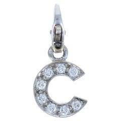 Chanel 18 Karat White Gold and Diamond C Pendant Charm 2.19g