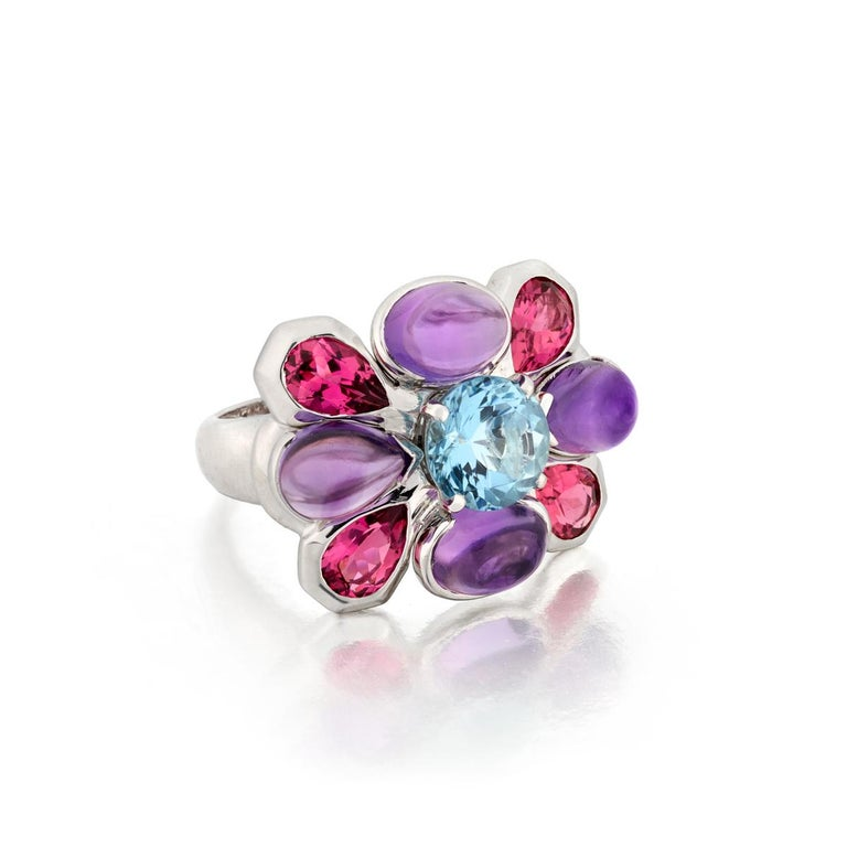 This Chanel ring is composed of 18K white gold with gemstones.  The ring is marked