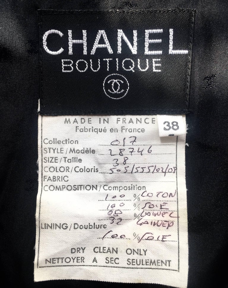 Chanel 1980s Boucle Black Wool and Pink Satin Jacket In Excellent Condition For Sale In London, GB