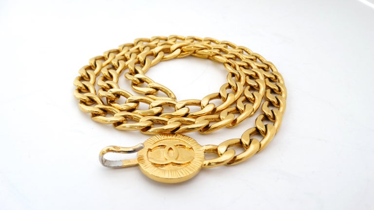 Complete your belt collection with this killer Chanel belt! Circa 1980s, this gold plated chain link belt features a pendant embossed with the iconic CC logo and a hook closure for easy size adjustment. Chic and timeless, this belt is a must have!