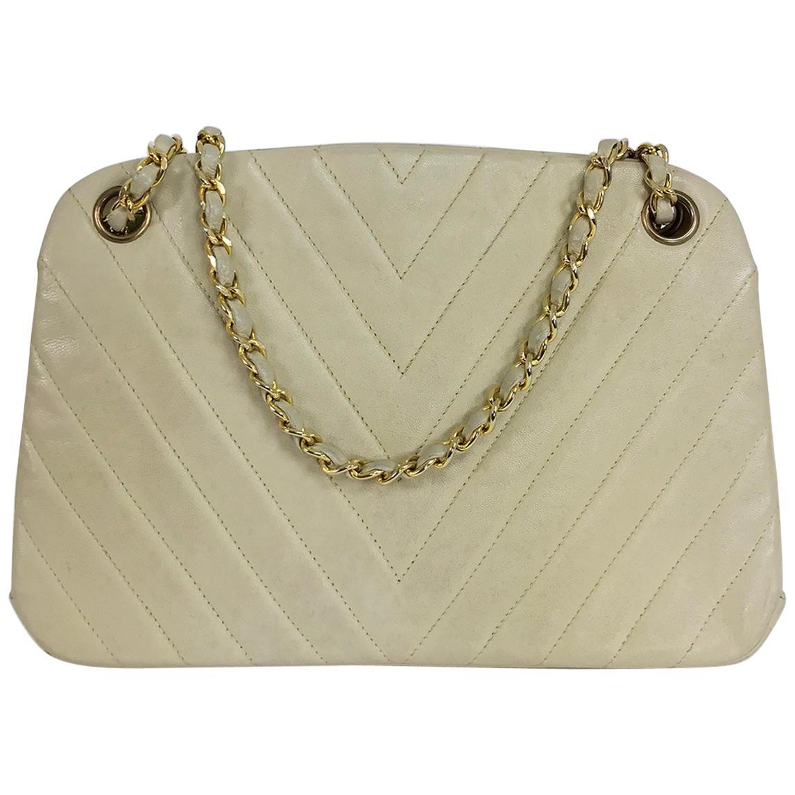 Chanel 1980s Ivory Chevron Kiss Lock Center Chain Handle Bag