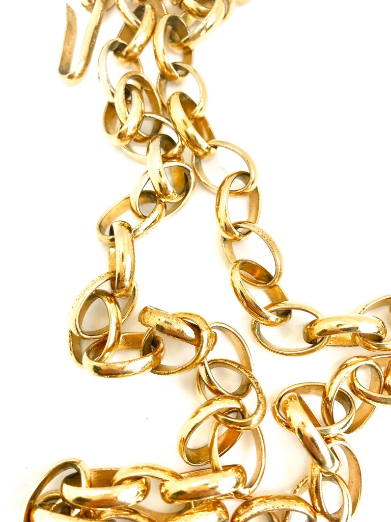 Huge Chanel 1980s vintage gold plated cutout pendant necklace / belt.  Chanel your inner 90s supermodel!  Features Chanel stamp on hook which was used briefly in the early 80s.  Long chunky chain which can be worn as a necklace or belt.  Chain