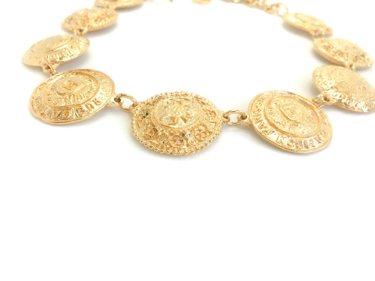 Chanel 1980s Vintage Medallion Necklace  CHANEL 31 Rue Cambon Paris CC Medallion Gold Plated Necklace.  This stunning necklace is collar length with antique Chanel medallions. Classic 80s chanel collectors item from the Victoire de Castellane