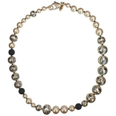 Chanel 1990's Faux Pearls with Coco Chanel Print on Strand