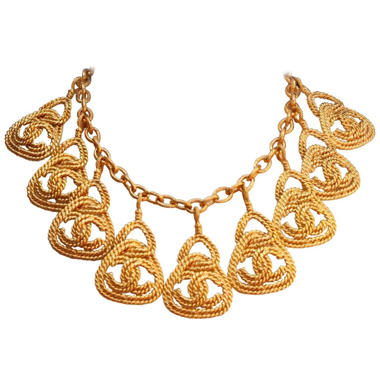 CHANEL 1990s Gilted metal necklace with openworked CC pendants For Sale
