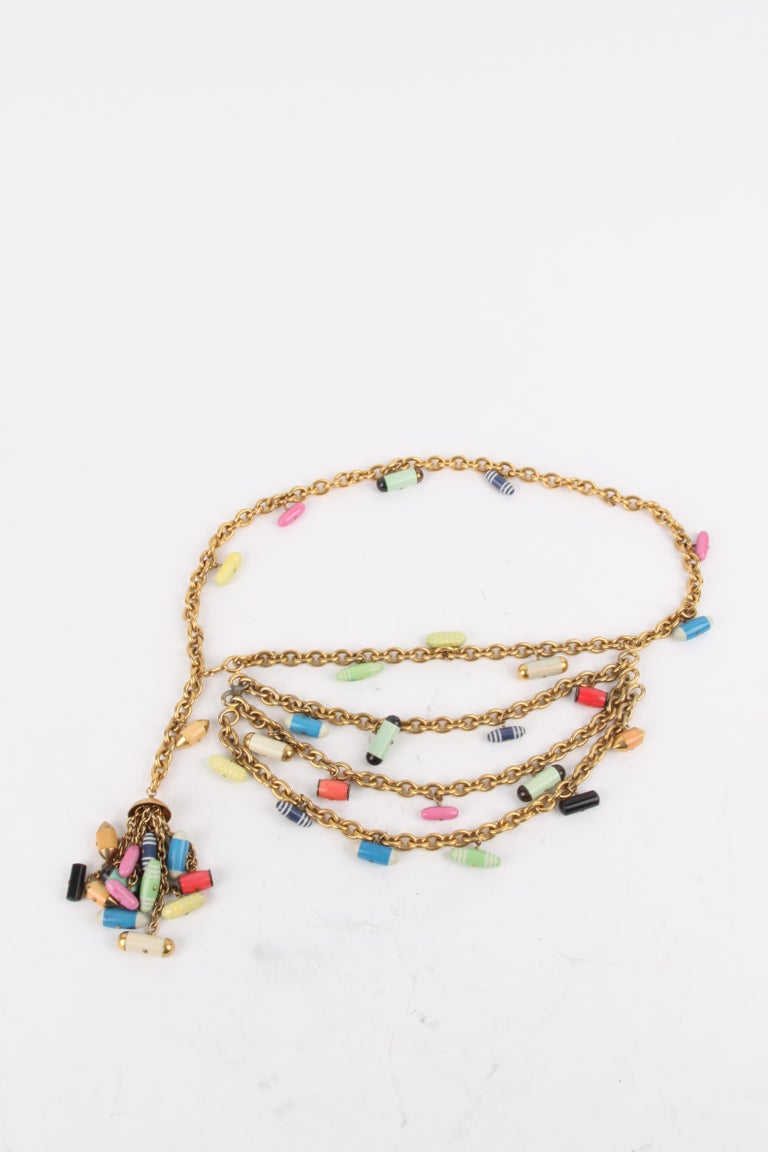 Chanel 1991 Fall/Winter (Collection 28) Gold Chain Multicolour Pill Capsule Belt.  This belt features a lux multicolour pill embellished exterior with shades of green, red, blue, orange, yellow, hot-pink, ecru, black and white. The belt features a