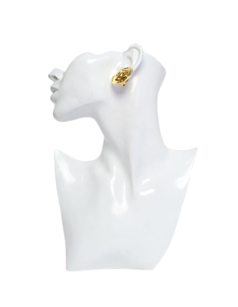 Chanel 1995 Goldtone CC Clip On Earrings Made In: France Year of Production: 1995 Color: Goldtone Materials: Metal Hallmarks:95 CC P Closure/Opening: Clip on closure Overall Condition: Very good pre-owned condition, with light hairline scratches to