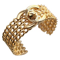 CHANEL 1996 P gilted metal twist lock cuff bracelet