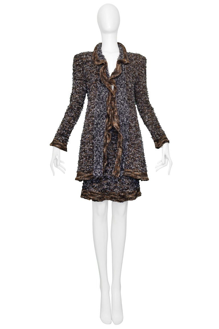 Resurrection Vintage is excited to offer a vintage Chanel black, brown, and grey sweater suit ensemble featuring a long skinny cardigan sweater with brown contrasting striped sleeves and hem, and a matching skirt.    Chanel, Paris Size Jacket 36,