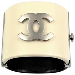 Chanel 2007  Black and Off White 2 1/8 Inch Wide Cuff With Silver Tone CC Logo