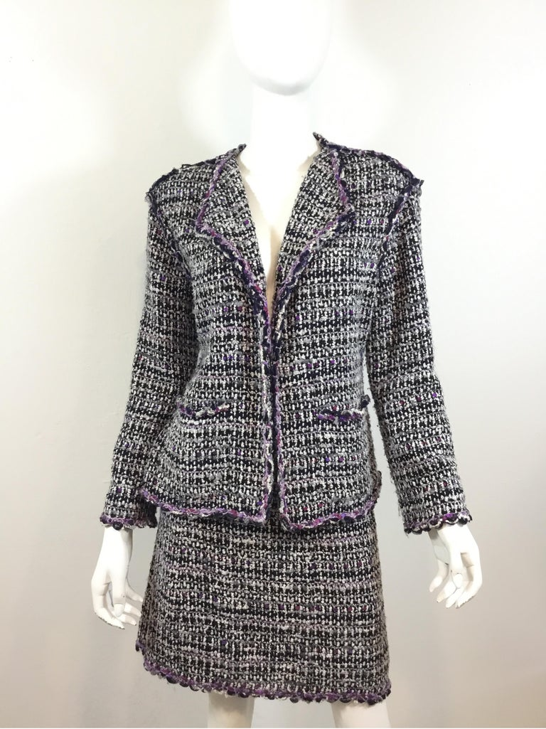 """Chanel purple/black fantasy Tweed jacket and skirt suit— Jacket is a size 40, skirt is a size 42. Made in France.  Jacket has an open front, two patch pockets, and a full lining. Skirt is fully lined and has a back zipper closure.  Jacket: bust 40"""","""
