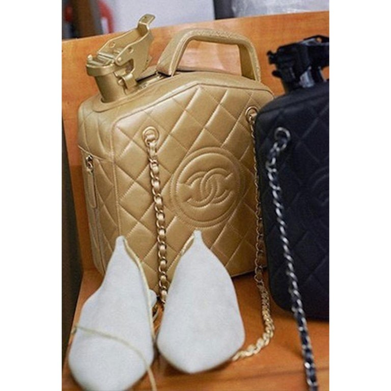 Chanel 2015 Paris Dubai Night Gas Tank Jerry Can Statement Bag Collector's Item  Cruise 2015 Paris-Dubai Collection. Gold hardware Single padded top handle Gold quilted lambskin leather Dual chain-link and leather shoulder straps Stitched CC accent