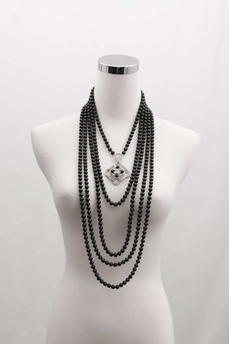 Chanel 2016 Black Beaded 5 Strand Necklace w/ Crystal CC Camellia In New Condition For Sale In Toronto, ON
