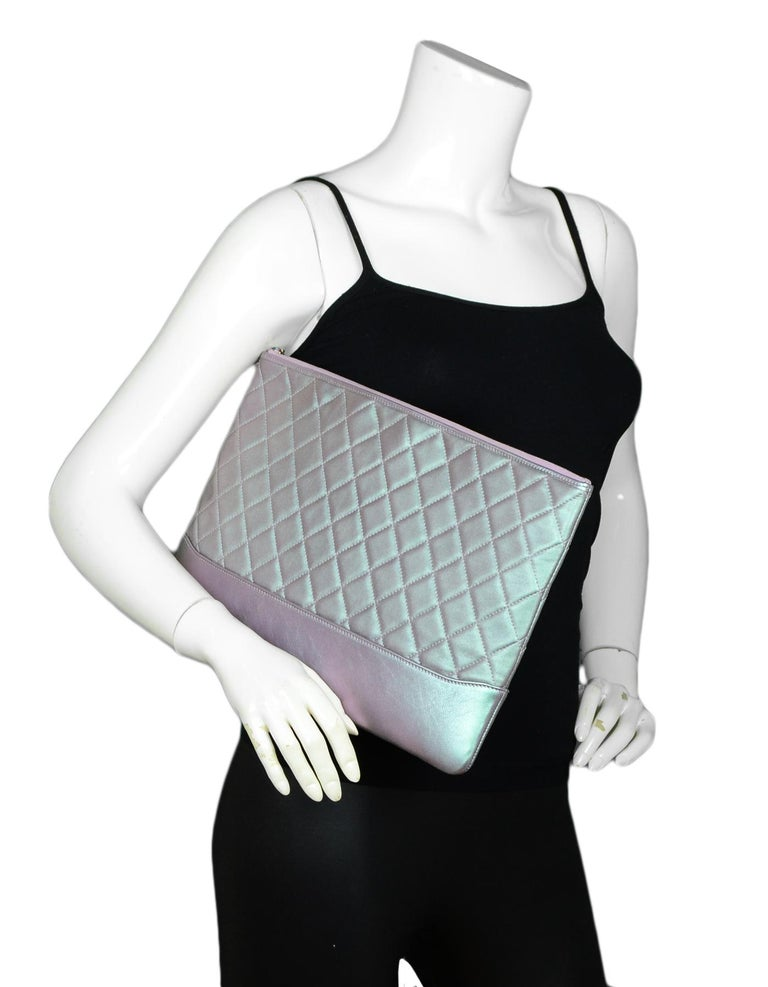 Chanel Light Purple Iridescent Lambskin Quilted Larger Gabrielle O-Case  Made In: Italy Year of Production: 2017 Color: Iridescent Light Purple Hardware: Silvertone Materials: Lambskin Leather Lining: Red fine textile Closure/Opening: Top