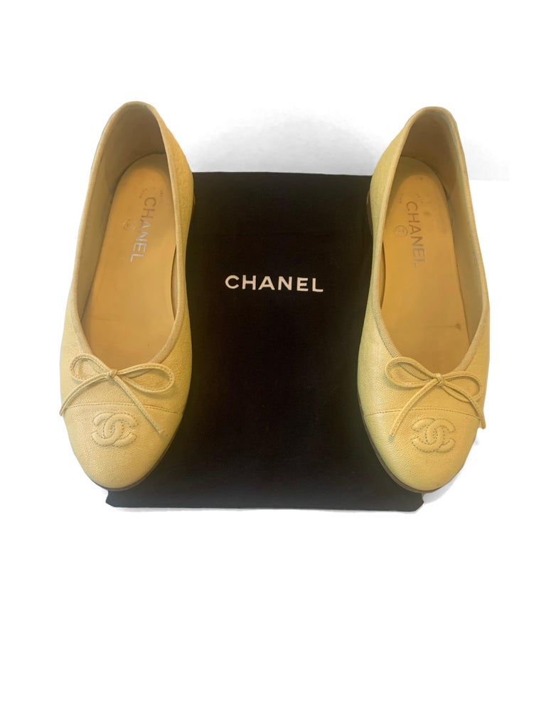 Chanel 2019 Iridescent Yellow CC Cap Toe Ballet Flats sz 39  Made In: Italy Year of Production: 2019 Color: Iridescent yellow Materials: Caviar leather Closure/Opening: Slide on Overall Condition: Very good pre-owned condition.  Scuffing throughout