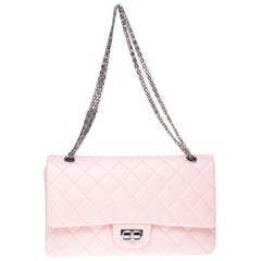 Chanel 2.55 double flap handbag in pink quilted leather and silver hardware