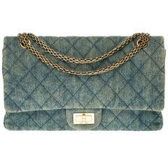 Chanel 2.55 Reissue 227 handbag in blue quilted denim with bronze hardware