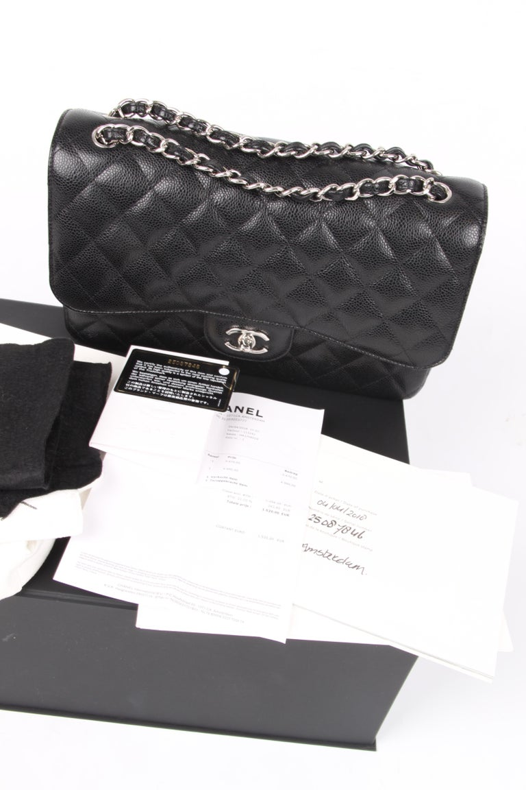 Oh yesss! Another classic bag by Chanel crafted in black caviar leather and silver-tone hardware A beauty!    This 2.55 jumbo single flap bag is the larger size of this classic model and measures 30 centimeters in length.  A silver-tone chain which