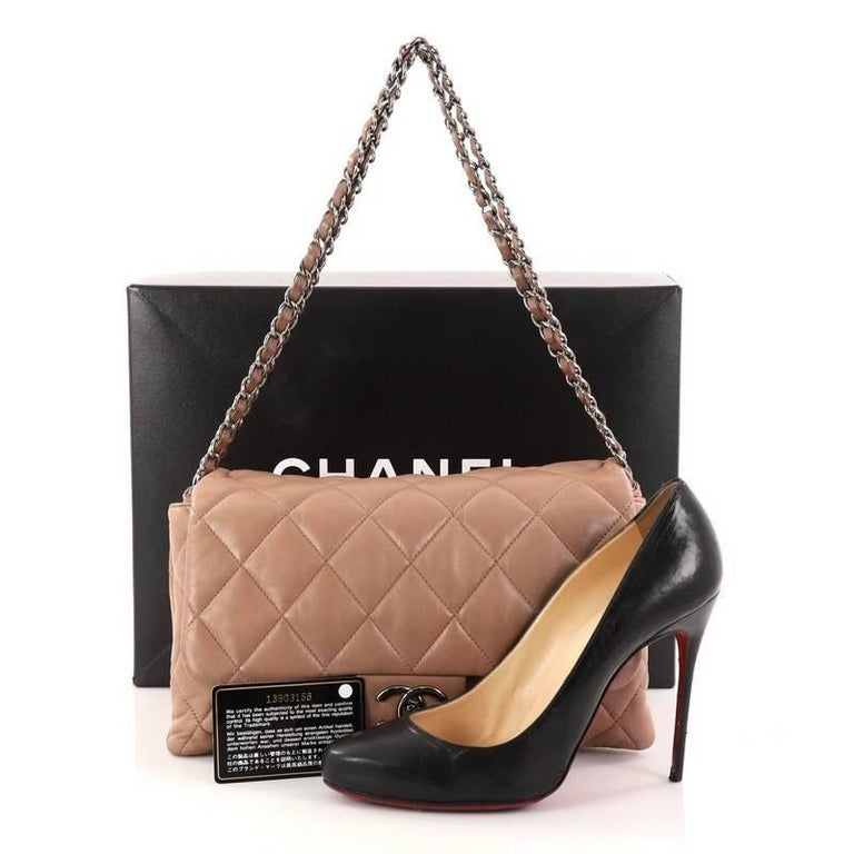 8627edf5fbc3 This authentic Chanel 3 Accordion Flap Bag Quilted Lambskin Jumbo is made  for everyday elegance.
