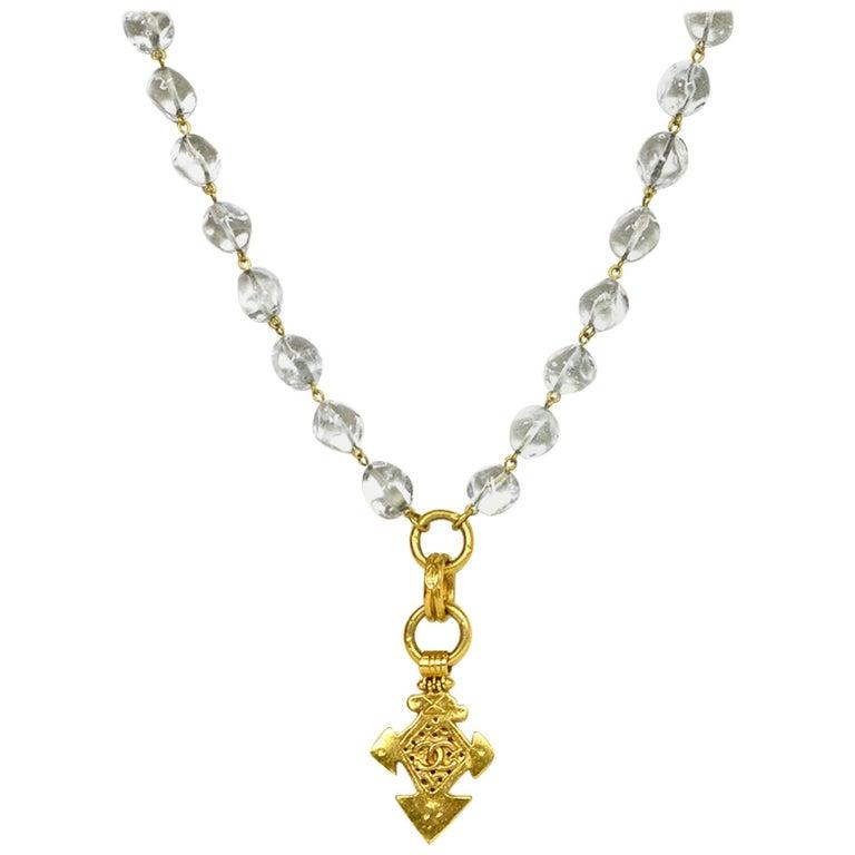 Chanel '90s Vintage Goldtone CC Pendant Necklace w/ Clear Beads For Sale