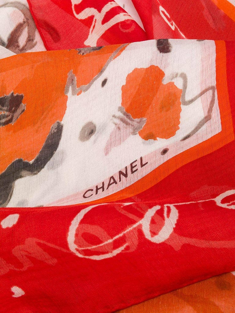 Crafted in France from the finest white silk, this pre-owned scarf by Chanel features a lightweight construction, a square shape and an all-over abstract print pattern in a vibrant pallet of orange, yellow and purple. For an added touch of
