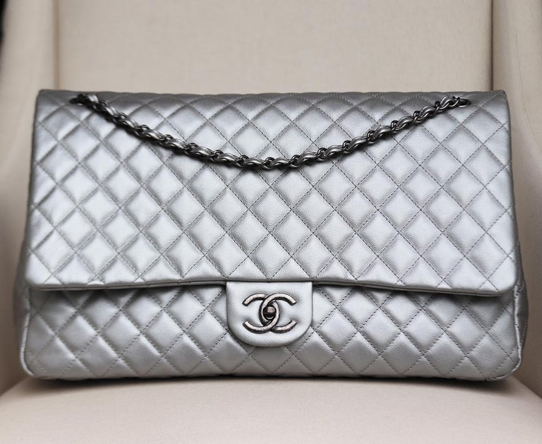 Chanel Airlines Large XXL Classic Flap Bag has been hand-finished by skilled artisans in the label's workshop, boasting silver quilted caviar calfskin-leather exterior, this design is accented with antiqued-silver and silk calfskin-leather chain