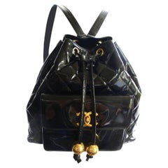 Chanel backpack black quiltet patent leather