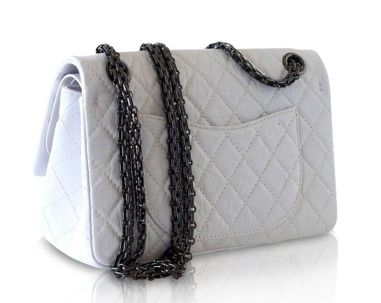 Chanel Small 255 double flap bag in unique chalk white distressed calfskin leather.   Hematite logo embossed Mademoiselle turnkey and link chain strap which can be doubled. Rear exterior slot pocket. Signature CHANEL stamp inside the bag.  Comes