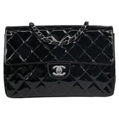 Chanel bag in black patent leather