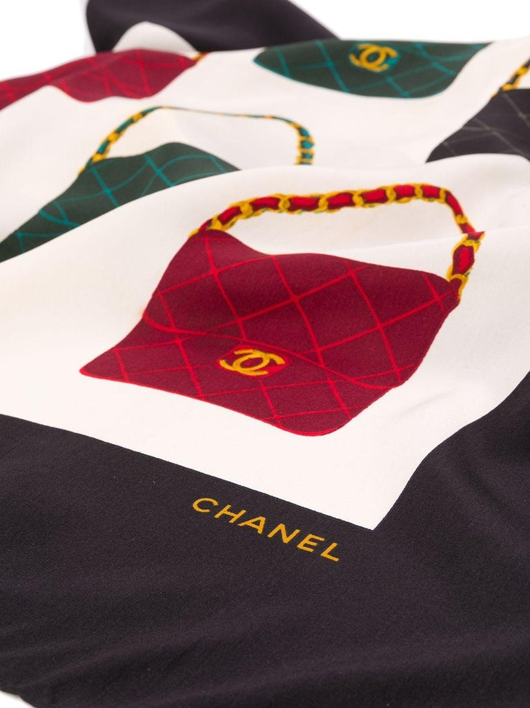 Crafted in France from the finest cream silk, this pre-owned scarf by Chanel features a lightweight construction, a square shape and an elegant, all-over print of the brand's signature 'CC embellished flap bag' in alternating patterns of black, red
