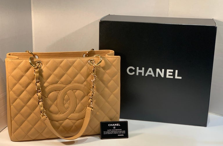 """Part of Chanel's classic Caviar Collection from 2014, this roomy pebbled leather estate purse is both chic and durable.  Chanel's versatile beige color #20. Shopping tote is richly textured, quilted both front and back, with a large, Chanel """"CC"""""""