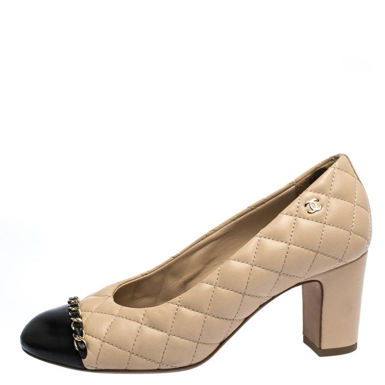 Pick your favourite pair of leather pumps and flaunt your stylish side. Chanel is an ideal pick when it comes to choosing the correct footwear for yourself. This black & beige pair has round cap toes, block heels and chain trims near the toes. Look