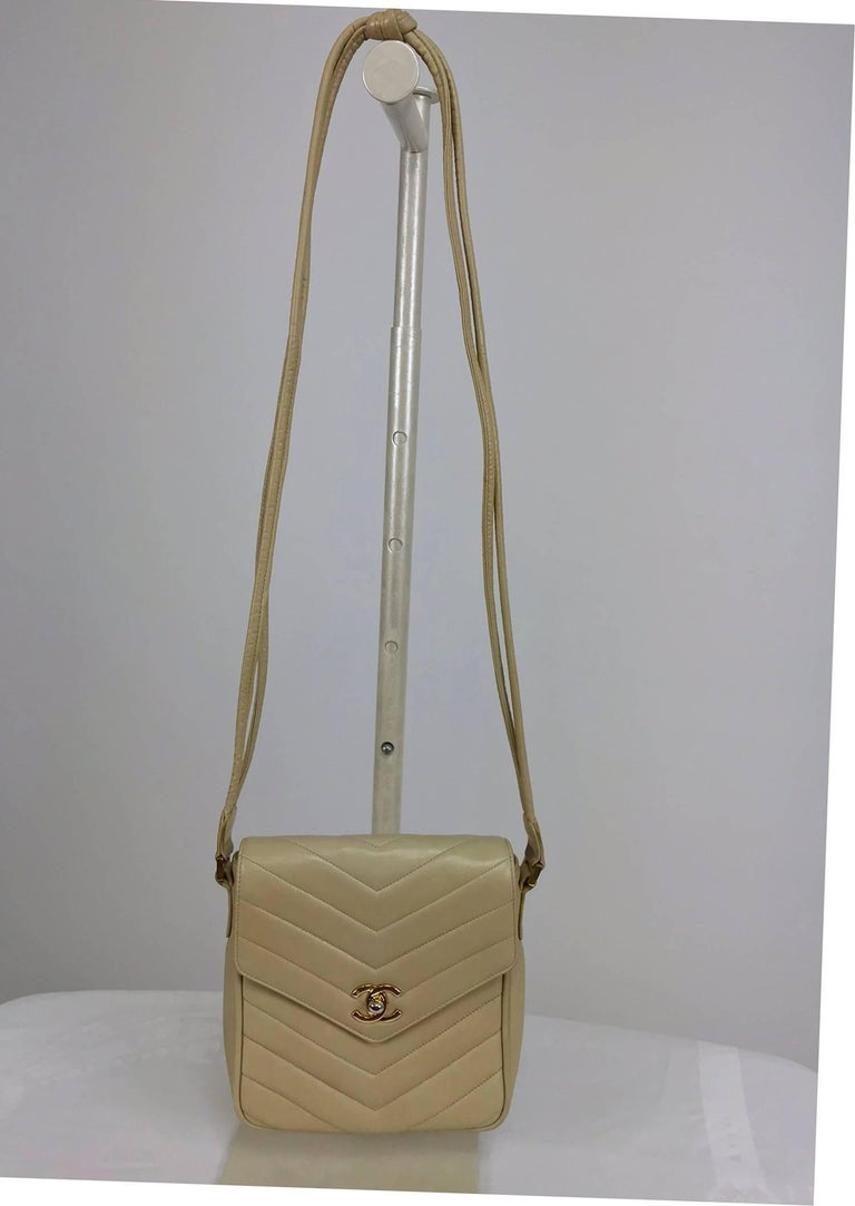 Chanel beige chevron leather  shoulder/cross body camera style handbag from the late 1980s...A beautiful bag with a lovely patina and perfect if a large bag is more than you need...Can be worn as a cross body, the strap drop is 18 inches, so check