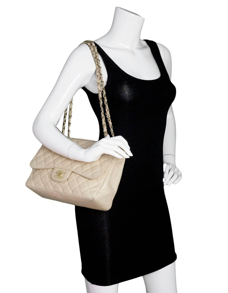Chanel Beige Quilted Caviar Jumbo Single Flap Bag Features adjustable shoulder strap  Made In: Italy Year of Production: 2009-2010 Color: Beige, gold Hardware: Goldtone Materials: Caviar leather and metal Lining: Beige leather Closure/opening: Flap