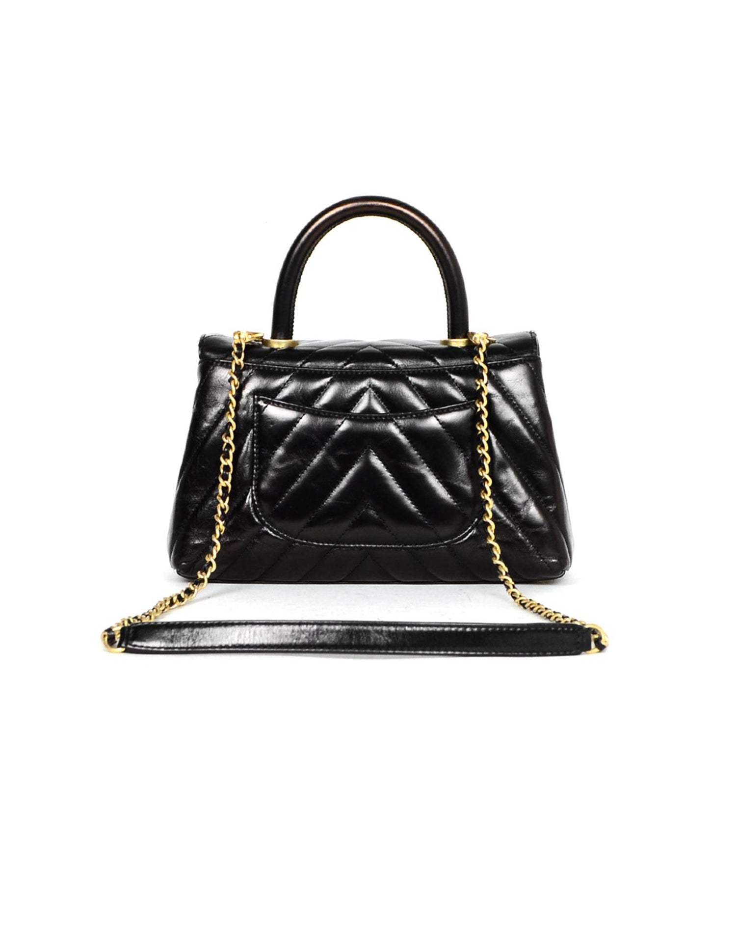 3d3d7d11b0ddac Chanel Black Shiny Calfskin Leather Chevron Quilted Mini Coco Handle Flap  Bag For Sale at 1stdibs
