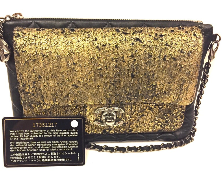 Chanel black and gold wallet/clutch with leather chain strap In Excellent Condition For Sale In Sheung Wan, HK