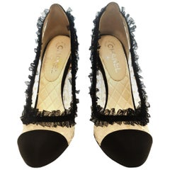 Chanel Black and Ivory Lace Pumps W/ Lace Ruffle Trim
