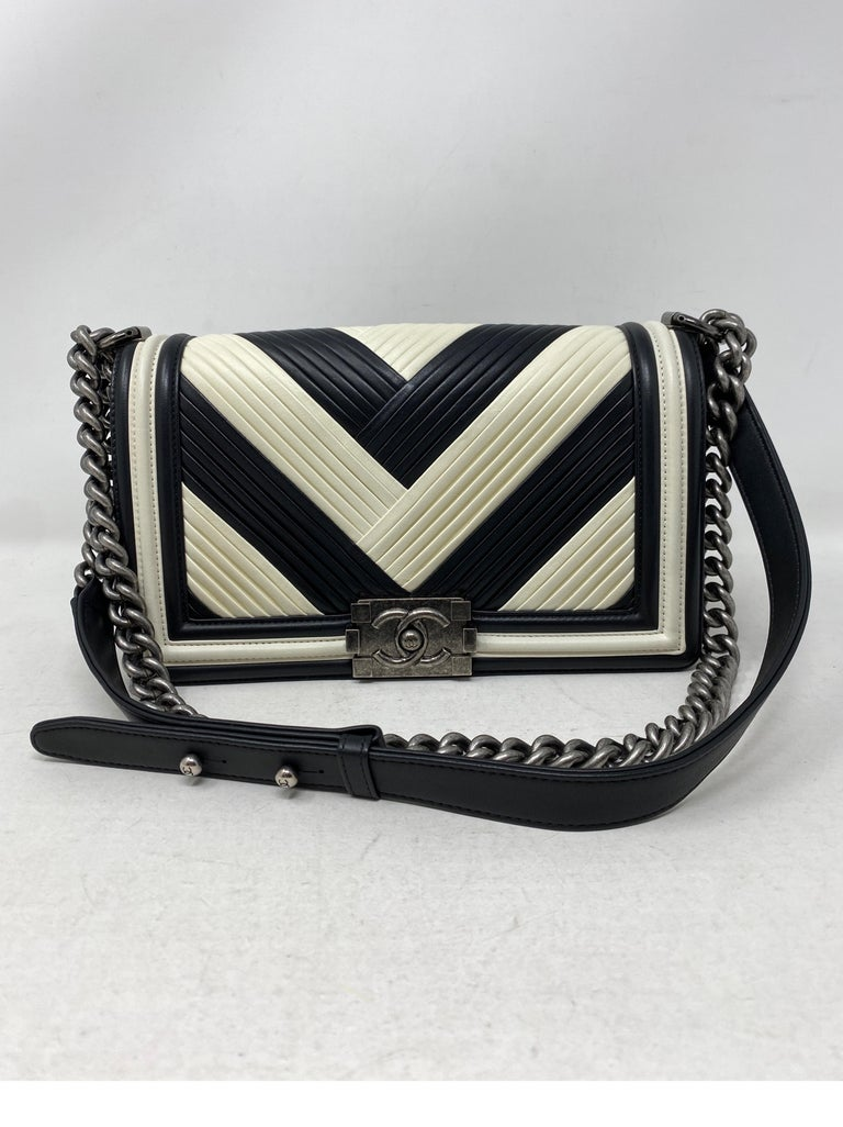 Chanel Black and White Chevron Boy Bag. Ruthenium hardware. Unique pattern and style. Excellent condition. Can be worn crossbody or doubled as a shoulder bag. Includes authenticity card. Guaranteed authentic.