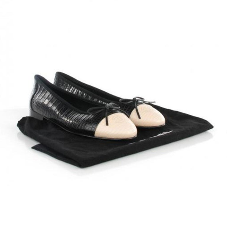 Limited Edition Chanel Crocodile Cap Toe Ballet Flats in a size 39.5 or 9.5 US . Retails for $8500 plus tax.  This style is a rare find that is unavailable in stores. These fabulous flats are a creation of crocodile skin. The shoe has a cap toe with