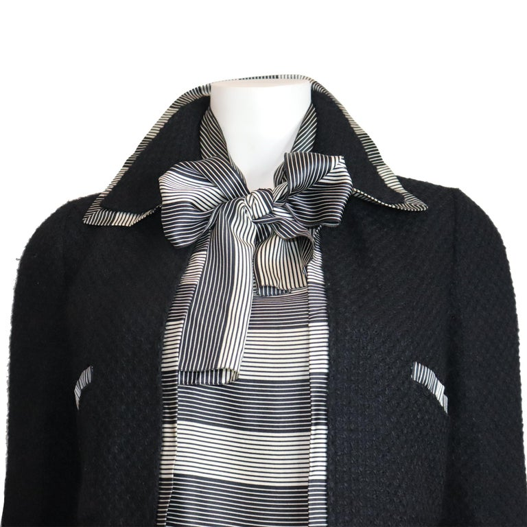 Chanel Black Boucle w/ Stripes and Gold Accents Skirt Suit (5PC) Circa 1990s. In excellent condition   Measurements-   Size: 34  Bust: 34 Inches  Waist: 27 Inches Hip: 35 Inches  Jacket Length: 20 Inches  Jacket Width: 16 Inches Shoulder to Arm: 23