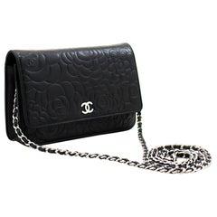 CHANEL Black Camellia Embossed WOC Wallet On Chain Shoulder Bag
