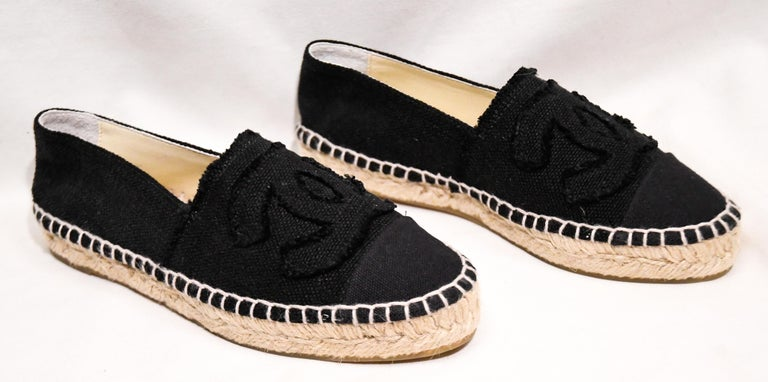 Chanel black linen canvas espadrille flats can enhance any style. These highly sought after espadrilles from Spring 2014, are a must have for any trendy fashionista! These flats include the signature woven rope Espadrille style and a large CC