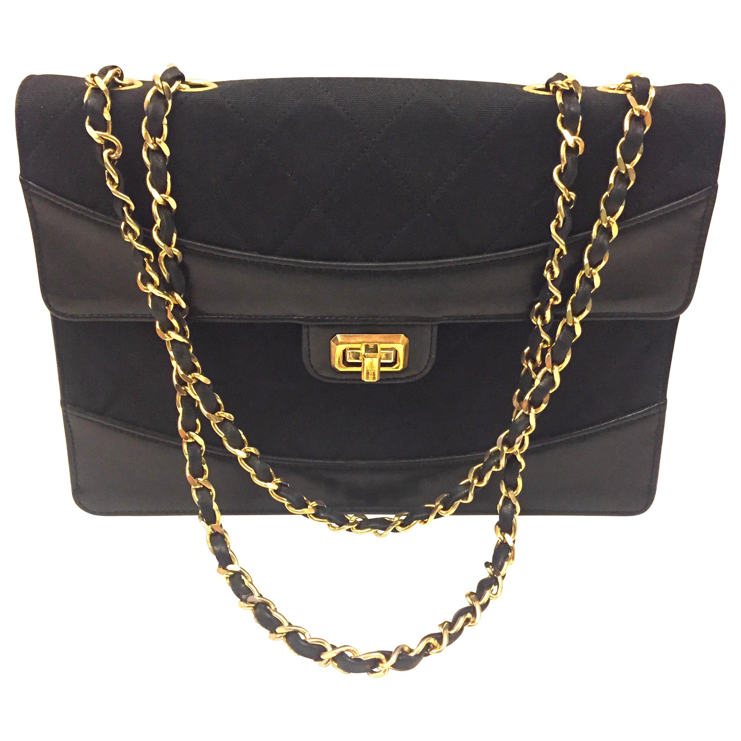 Chanel black canvas/leather shoulder bag